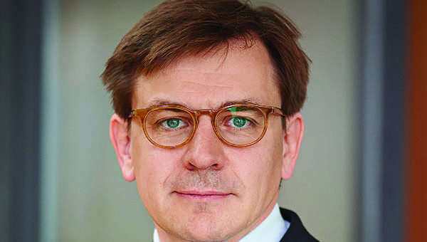 Hartwig Kos, Syz AM